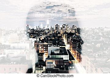 Hard work concept - Man head silhouette on bright city...