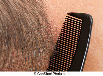 Man head with a comb.