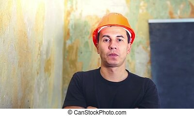 man helmet construction worker in hard hat is talking portrait