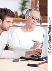 Man helping elderly lady
