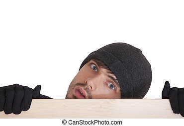 man hiding behind board