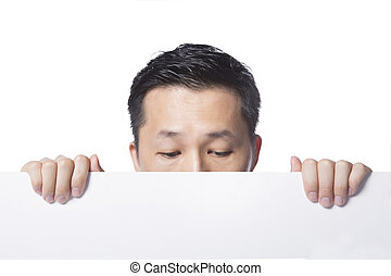 Man hiding behind the white paper