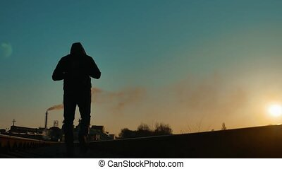 man hiker homeless person traveler walking by railroad...