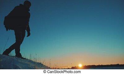 man hiker tourists slips falls come down from climber climb...