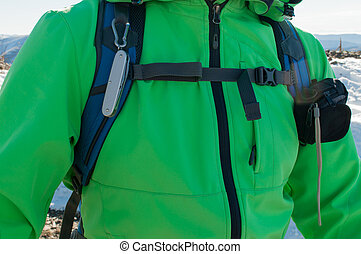 Man hiker with equipment on a mountain