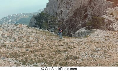 Man hiking aerial view - Man traveling with backpack hiking...