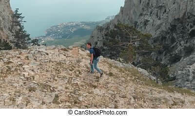 Man hiking and taking picture of nature - Man traveling with...