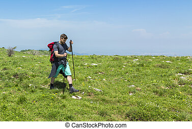 Man Hiking in Green Mountains