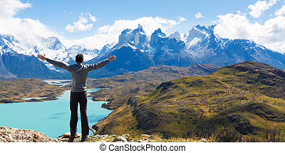 man hiking in patagonia - man at mirador condor enjoying...