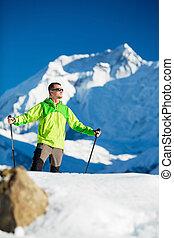Man hiking in winter Himalaya Mountains