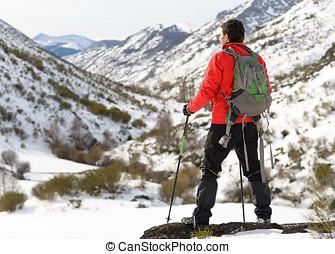 Man hiking on winter trip