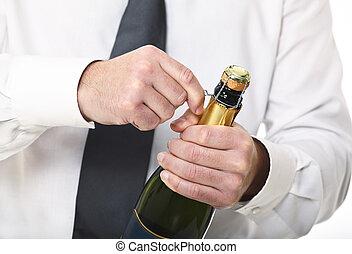 man hold champagne bottle