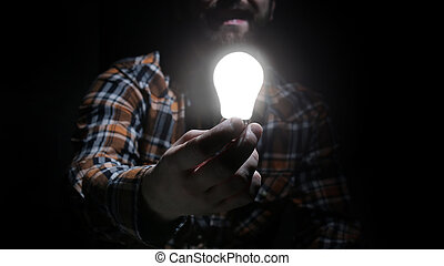 man hold glow lamp in hand