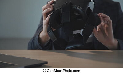 Man holding 3d vr glasses in hands and sitting in office