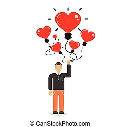 Man holding a balloon in the form of heart.Freedom concept.