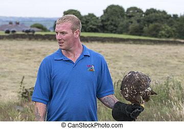 Man holding a Buzzard