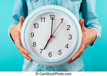 Man holding a clock