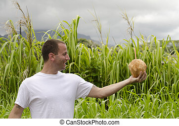 Man holding a coconut.