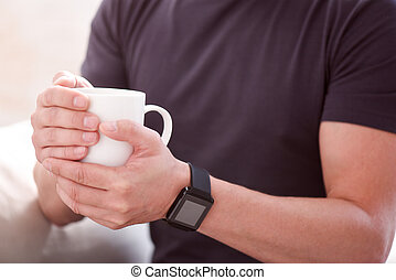 Man holding a cup in both hands