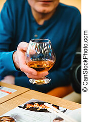 Man holding a glass of alcohol drink whiskey