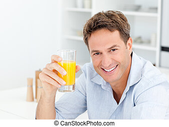 Man holding a glass of orange juice
