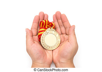 man holding a gold medal on a white background