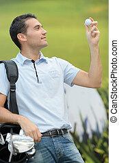 man holding a golf ball
