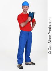 Man holding a jigsaw
