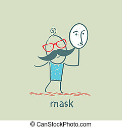 man holding a mask