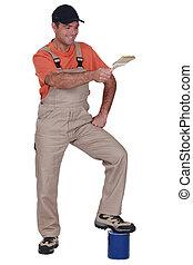 Man holding a paintbrush
