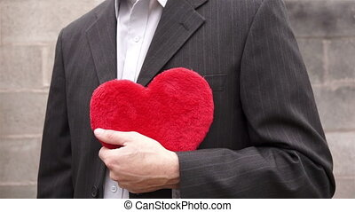 Man Holding a Red Fuzzy Heart - Close up shot of an...