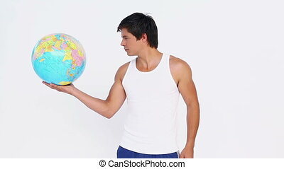 Man holding a sphere in a hand