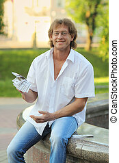man holding a stack of money