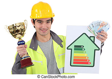 Man holding a trophy and money