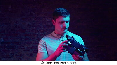 Man holding a VR headset