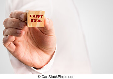 Man holding a wooden block reading - Happy hour