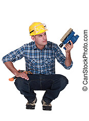 Man holding an electric sander