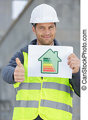 man holding an energy efficient chart