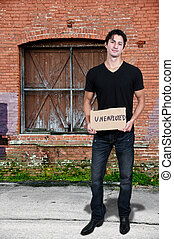 Man Holding an Unemployment Sign