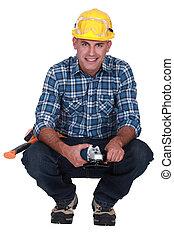 Man holding angle-grinder