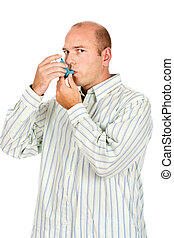 Man holding asthma medicine inhaler