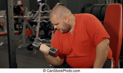 Man holding barbell in hands and workout in gym - Profile...