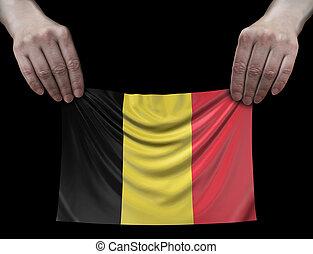 Man holding Belgian flag