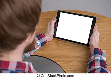 Man holding black digital tablet device with white blank screen - mockup image