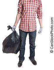 Man holding black plastic trash bag in his hand