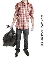 Man holding black plastic trash bag