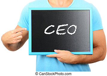 Man holding blackboard in hands and pointing the word CEO