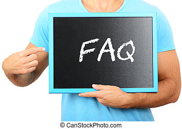 Man holding blackboard in hands and pointing the word FAQ