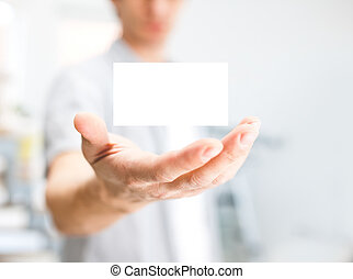 Man holding blank business card with copy space, small dof