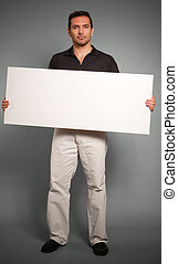 Man holding blank message board